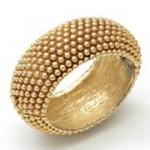 Bracelet rigide, métal doré, inspiré du pommeau de canne de Monsieur Saint Laurent