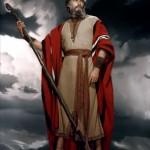 Charlton Heston en Moïse tenant son bâton